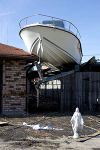 Boat atop houses