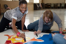 students painting on MLK Day