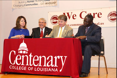 President David Rowe with Mr. Mack McCarter of CRI, Mr. Lee Jeter of the Fuller Center, and Mrs. Donna Curtis of Shreveport Green